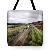 The Railroad To....in Scotland With Clouds Hanging Over The Mountains. Tote Bag