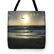 The Sun Is Rising Over The Ocean Tote Bag