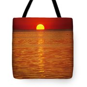 The Sun Sinks Into Pamlico Sound Seen Tote Bag