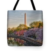 The Washington Monument And The Cherry Blossoms Tote Bag