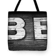 The Word Be Painted On The Side Of Old Building Tote Bag
