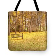 The Yellow Leaves Of Fall Carpet The Ground Of A Ginkgo Biloba Grove. Cm3 Tote Bag