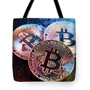 Three Bitcoin Coins In A Colorful Lighting. Tote Bag