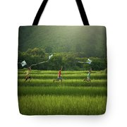Three Boys Are Happy To Play Kites At Summer Field In Nature In  Tote Bag