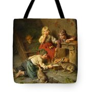 Three Children Feeding Rabbits Tote Bag
