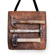 Three Hammers Against A Rust Background Tote Bag