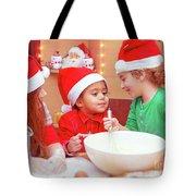 Three Kids Making Christmas Cookies Tote Bag