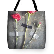 Three Red Flowers Taped To Wooden Background Tote Bag