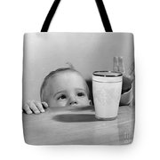 Toddler Reaching For Glass Of Milk Tote Bag