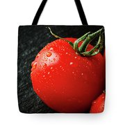 Tomatoes Close Up On Black Slate Tote Bag