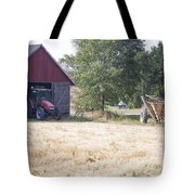 Tractor At A Wheat Field Tote Bag