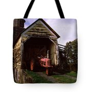 Tractor Parked Inside Of A Round Barn Tote Bag