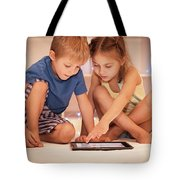 Two Happy Children Playing On The Tablet Tote Bag