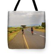 Two Men Riding Bicycle In Tanzania Tote Bag