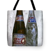 Two Pepsi Bottles On A Table Tote Bag by Daniel Hagerman