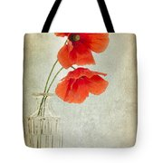 Two Poppies In A Glass Vase Tote Bag