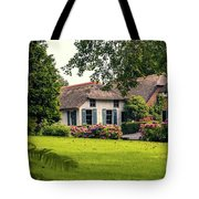 typical dutch county side of houses and gardens, Giethoorn Tote Bag