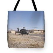 Uh-60 Black Hawk Helicopter Lands Tote Bag
