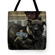 U.s. Air Force Soldier Giving Tote Bag by Stocktrek Images