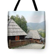 Village With Wooden Cabin Log On Mountain Tote Bag