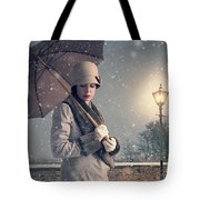Vintage Woman With Coat Hat And Umbrella Outside In Snow Tote Bag