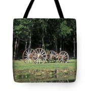 Wagon Wheels Reflecting In A Pond Tote Bag