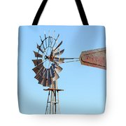 Water Pump Windmill On Blue Sky Background Tote Bag