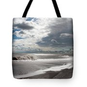 Waves Breaking Against The Beach And Cloud Streaming Above  Skegness Lincolnshire England Tote Bag