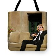 Wealthy Young Man In Suit Sitting On A Couch With A Drink On A T Tote Bag