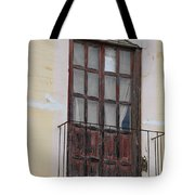 Weathered Red Door On A Balcony Tote Bag