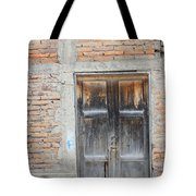 Weathered Wood Door In An Adobe Brick Wall Tote Bag