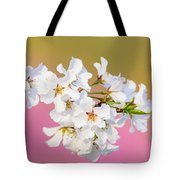 White Cherry Blossoms Against A Pink And Gold Background Tote Bag
