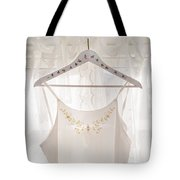 White Dress On Clothes Hanger Tote Bag