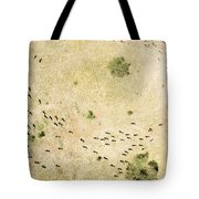 Wildebeest Disperse Over The Serengeti Tote Bag