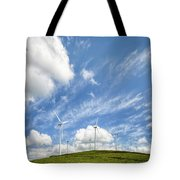 Wind Turbines On A Hill Under A Blue Sky Tote Bag
