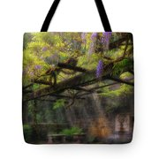 Wisteria Flowers Blooming On Trellis Over Water Fountain Tote Bag