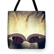 Woman Holding An Open Book Bursting With Light. Tote Bag