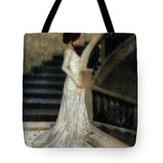 Woman In Lace Gown On Staircase Tote Bag