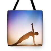 Woman In Side Balance Yoga Meditating At Sunset Tote Bag