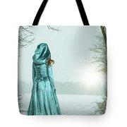 Woman In Snowy Landscape Tote Bag