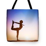 Woman In The Dancer Yoga Pose Meditating At Sunset Tote Bag