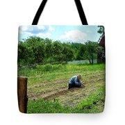 Woman Planting Garden Near Barn Tote Bag
