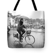 Woman Riding In The Raing Tote Bag