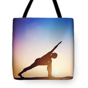 Woman Standing In Revolved Side Angle Yoga Pose Meditating At Sunset Tote Bag