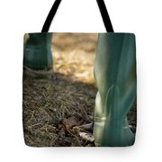 Woman Walking In Field In Green Boots Tote Bag