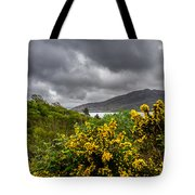 Yellow Flowers And Grey Clouds, Stormy Weather Over Sea In Scotland. Tote Bag