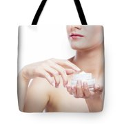 Young, Attractive Woman Using A Moisturizer. Tote Bag