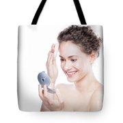 Young Beautiful Woman Applying Powder On Her Skin. Tote Bag