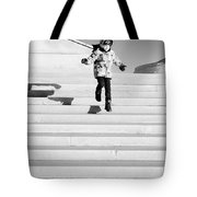 Young Child Jumping Down Steps Tote Bag