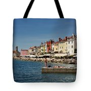 Young Couple Fishing Reading Sunbathing On Dock At Piran Sloveni Tote Bag